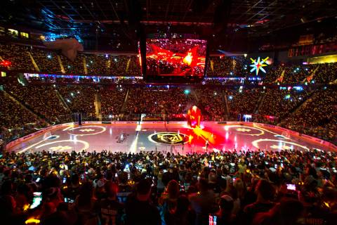 Lighted bracelets twinkle on the wrists of Vegas Golden Knights fans before the start of the fi ...