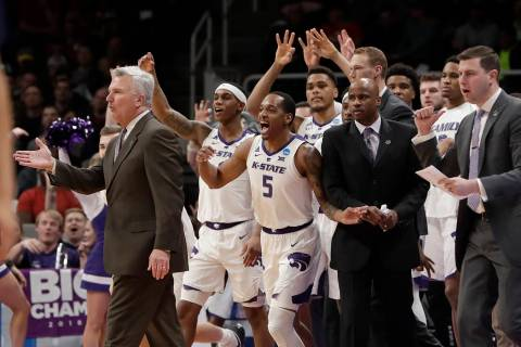 Kansas State head coach Bruce Weber, left, gestures as players celebrate during the first half ...