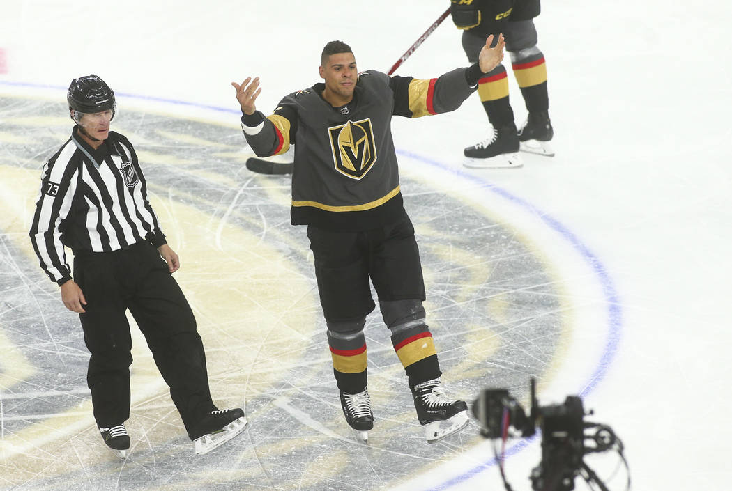 Golden Knights' Ryan Reaves motions to the crowd after fighting Ottawa Senators' Scott Sabourin ...