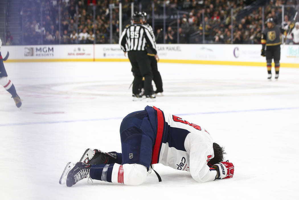 Washington Capitals right wing Tom Wilson reacts after taking a hit from Golden Knights right w ...