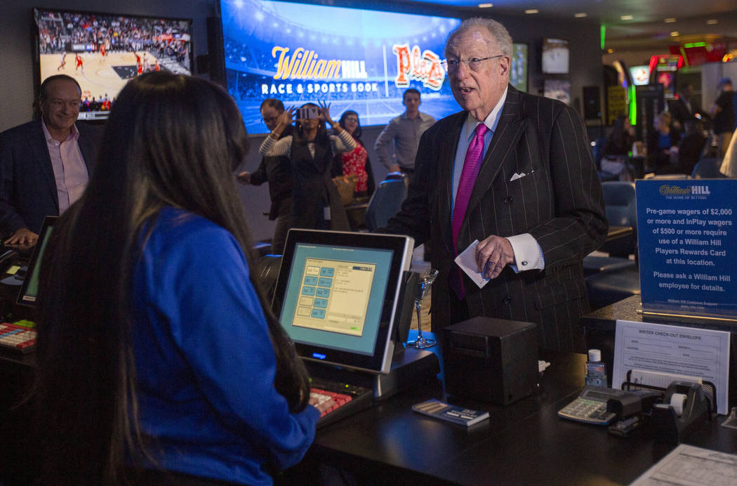 Former Las Vegas Mayor Oscar Goodman places the first bet at the William Hill Race & Sports …