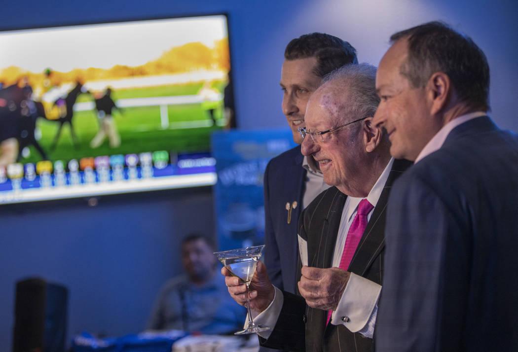 Plaza CEO Jonathan Jossel, left, former Las Vegas Mayor Oscar Goodman, center, and William Hill ...
