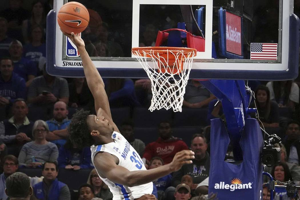 Memphis' James Wiseman (32) dunks against South Carolina State during the first half of an NCAA ...