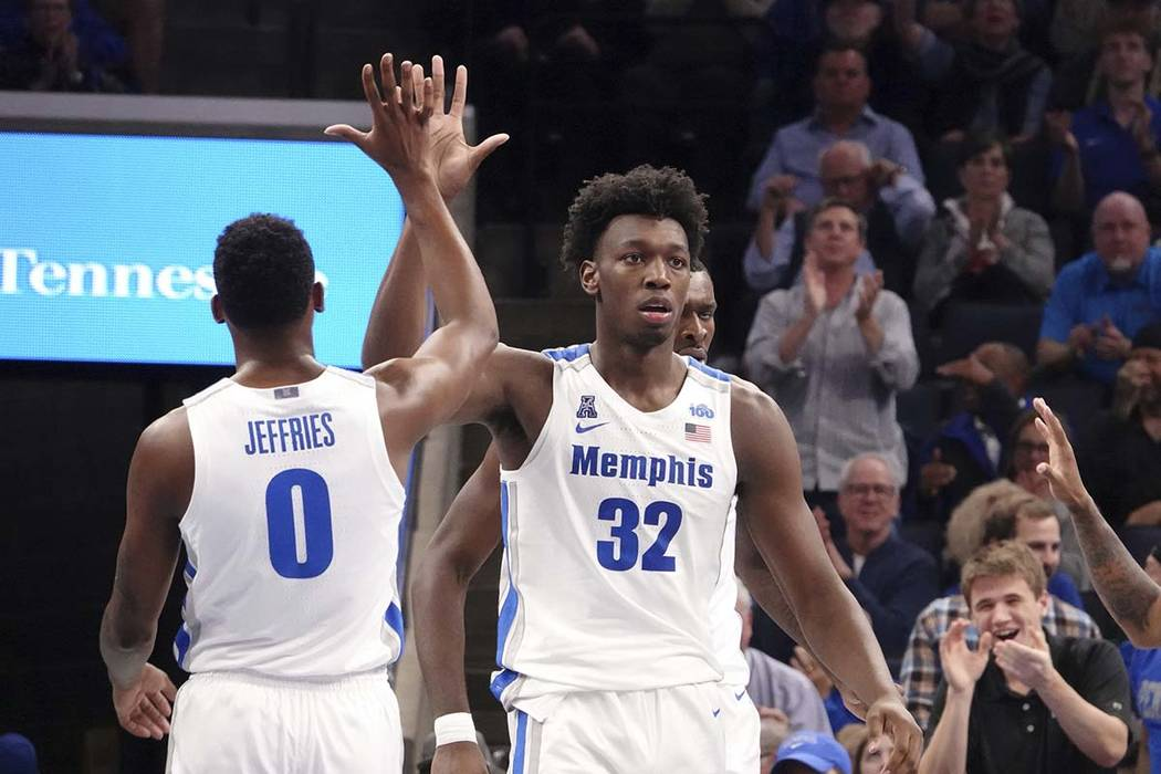 Memphis' James Wiseman (32) is congratulated by D.J. Jeffries (0) during the first half of an N ...