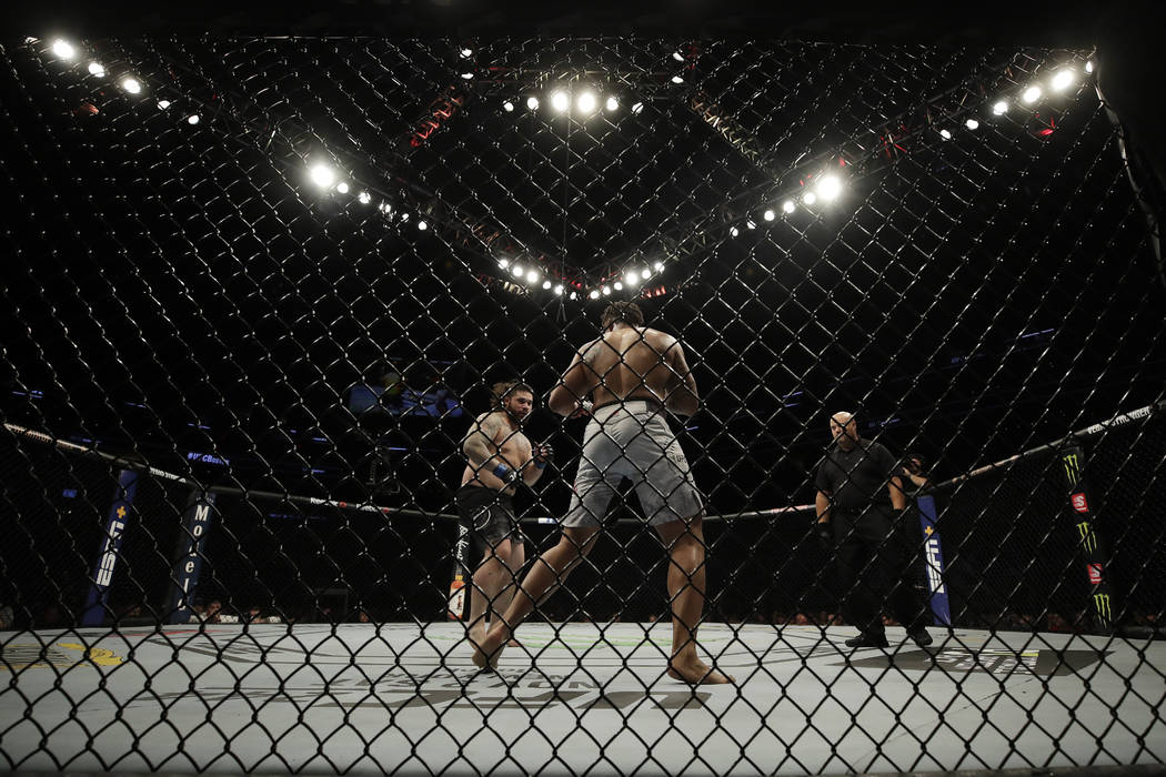 Ben Sosoli, left, fights Greg Hardy during a heavyweight mixed martial arts bout, Friday, Oct. ...