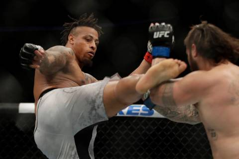 Greg Hardy kicks Ben Sosoli during a heavyweight mixed martial arts bout, Friday, Oct. 18, 2019 ...