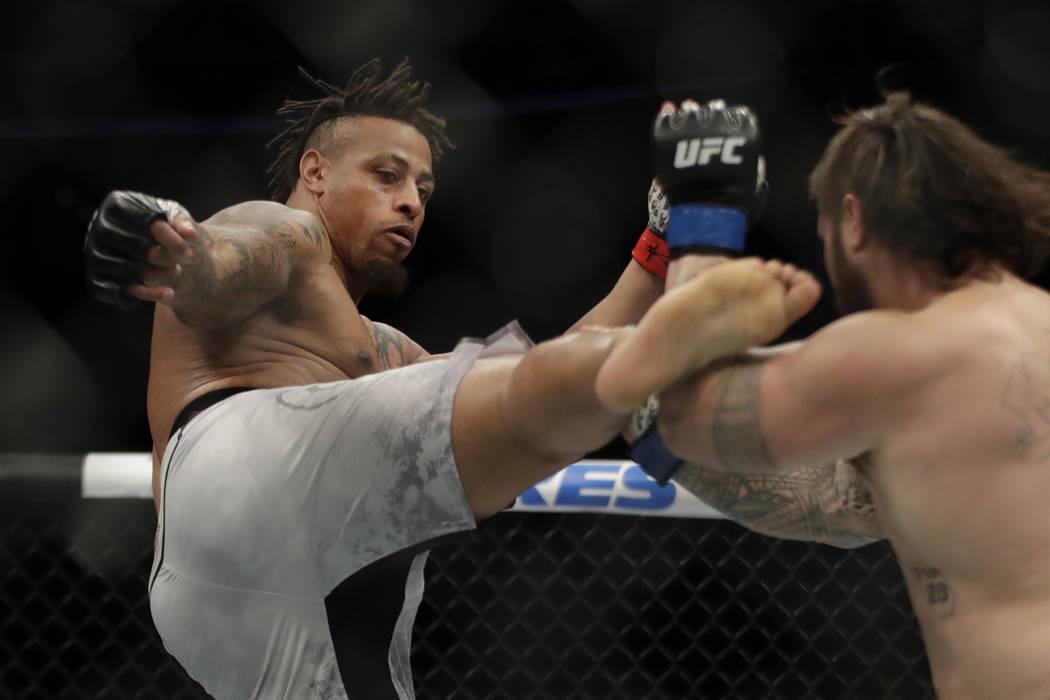 Greg Hardy kicks Ben Sosoli during a heavyweight mixed martial arts bout, Friday, Oct. 18, 2019 ...