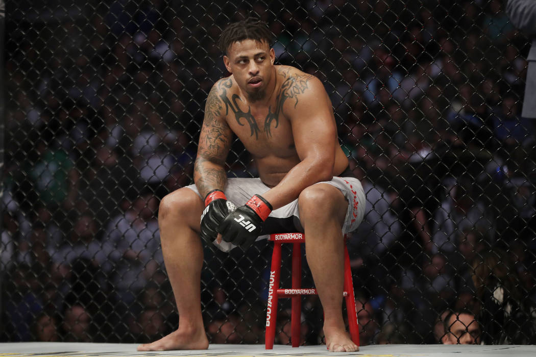 Greg Hardy sits during a break in a heavyweight mixed martial arts bout against Ben Sosoli, Fri ...