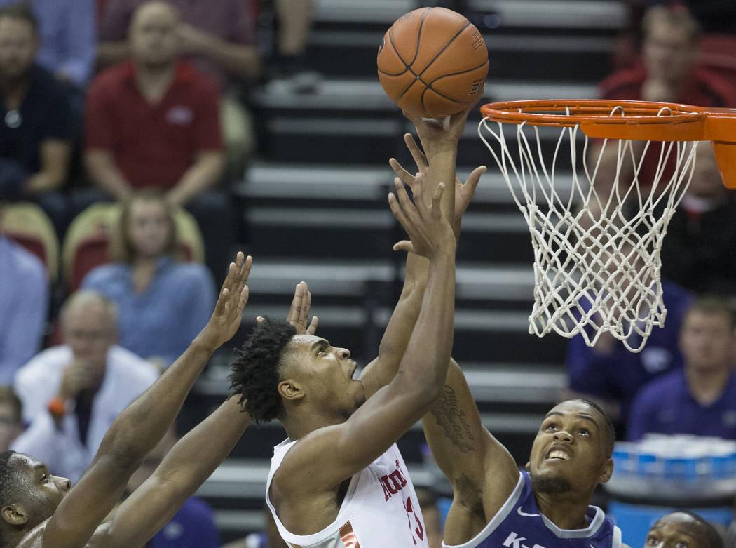 UNLV Rebels guard Bryce Hamilton (13) splits Kansas State defenders Montavious Murphy (23) and ...