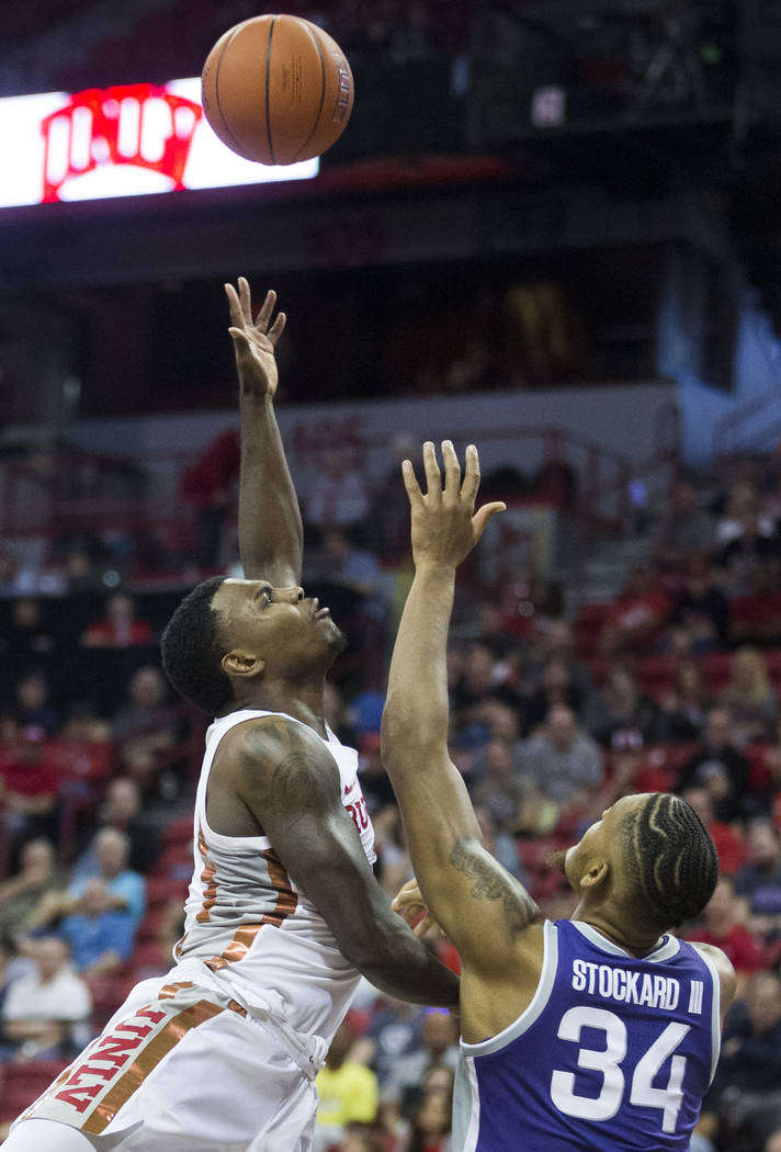 UNLV Rebels guard Amauri Hardy (3) slices to the rim over Kansas State Wildcats forward Levi St ...