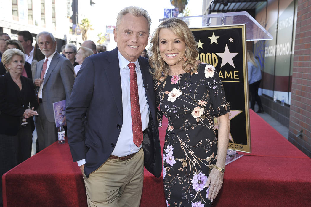 """Pat Sajak, left, and Vanna White, from """"Wheel of Fortune,"""" attend a ceremony honoring ..."""