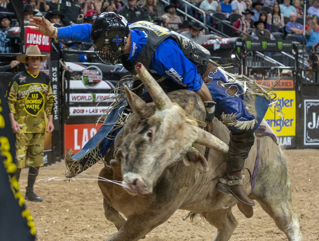 Eduardo Aparecido battles Trail of Tears during the third day of the PBR World Finals at T-Mobi ...