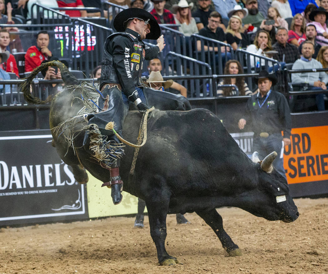 Taylor Toves stays atop Gangster Time during the third day of the PBR World Finals at T-Mobile ...