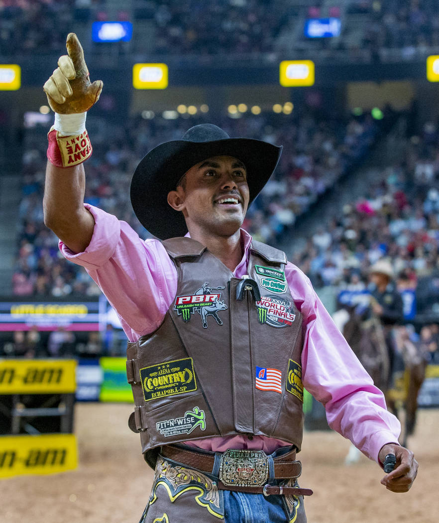 Lucas Davino celebrates a successful ride atop Little Scarfo during the third day of the PBR Wo ...