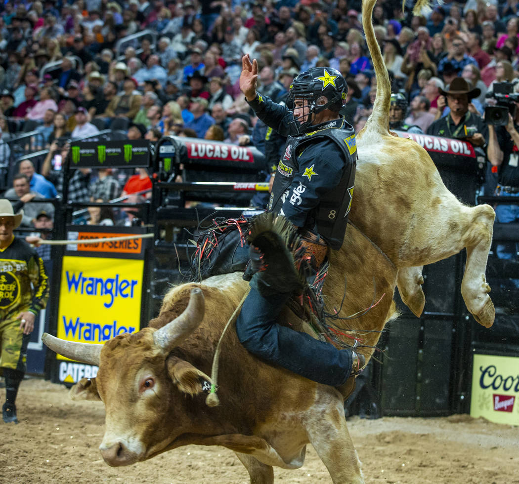 Ramon de Lima leans back on Switchback during the third day of the PBR World Finals at T-Mobile ...