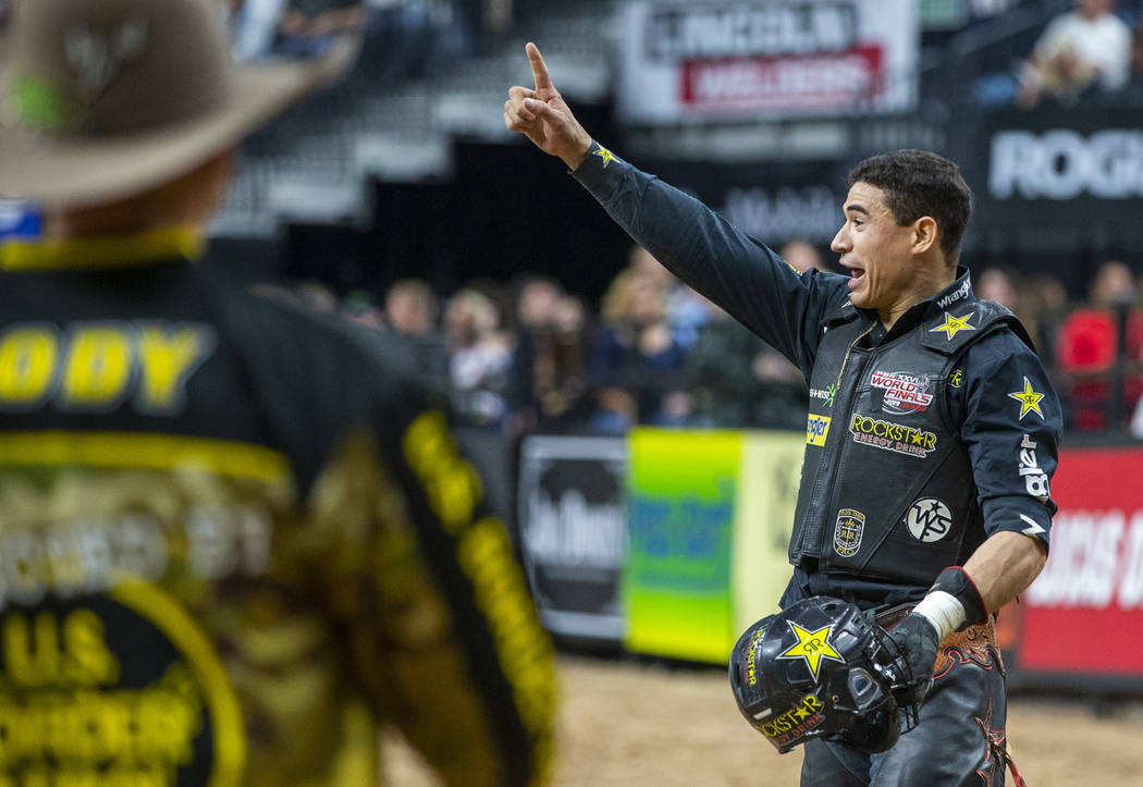 Ramon de Lima is pleased with his ride on Switchback during the third day of the PBR World Fina ...