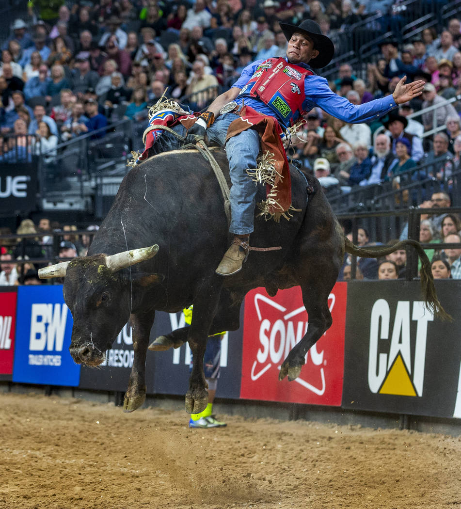 Alisson De Souza leans back on Fly Over during the third day of the PBR World Finals at T-Mobil ...