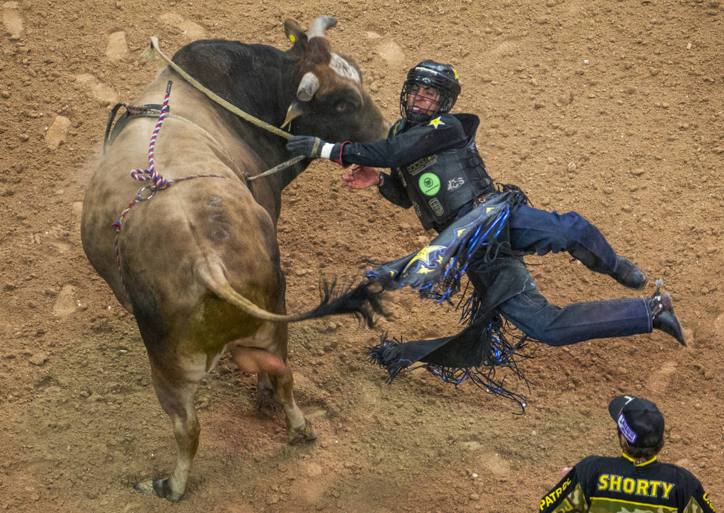 Luciano De Castro falls sideways off of Happy Camper during the third day of the PBR World Fina ...