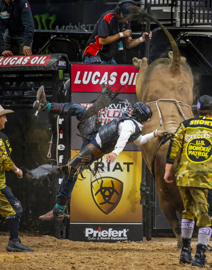 Austin Richardson hangs on to the rope while bucked off of Red Dawn during the third day of th ...