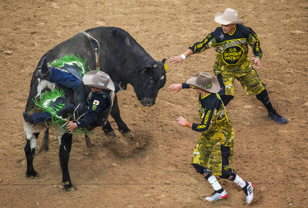 Marco Eguchi falls off the back of Wild Child during the third day of the PBR World Finals at T ...