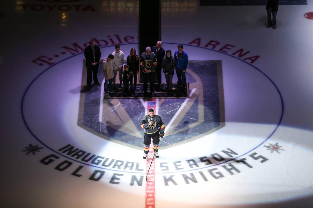 Vegas Golden Knights defenseman Deryk Engelland (5), center, speaks during a ceremony honoring ...