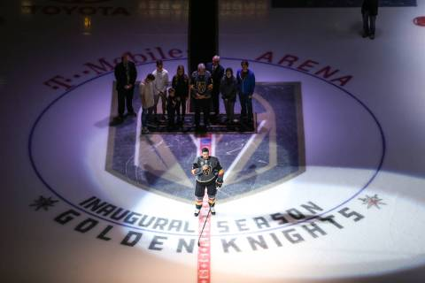 Vegas Golden Knights defenseman Deryk Engelland (5), center, speaks during a ceremony honoring ...