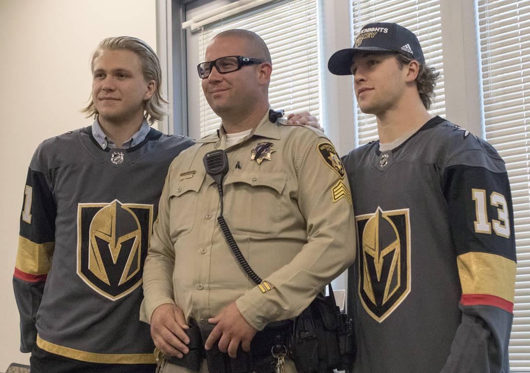 Vegas Golden Knights center William Karlsson (71), left, Metro sergeant Mike Calarco, center, a ...