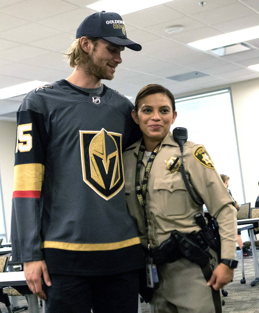 Vegas Golden Knights defenseman Jon Merrill (15) with Metro detective Maria Fulwiler during a t ...