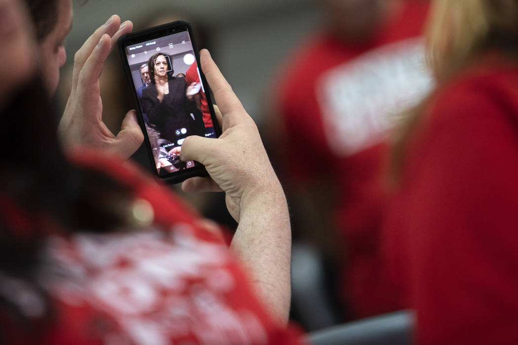 Presidential candidate and California Sen. Kamala Harris is seen through a union member's phone ...