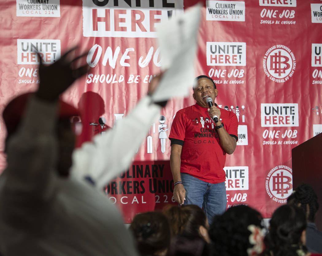 The crowd roars as Las Vegas Culinary Union Vice President Leain Vashon leads chants at a town ...