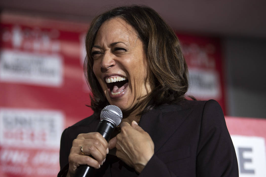 Presidential candidate Kamala Harris laughs while speaking to the crowd at a town hall hosted b ...