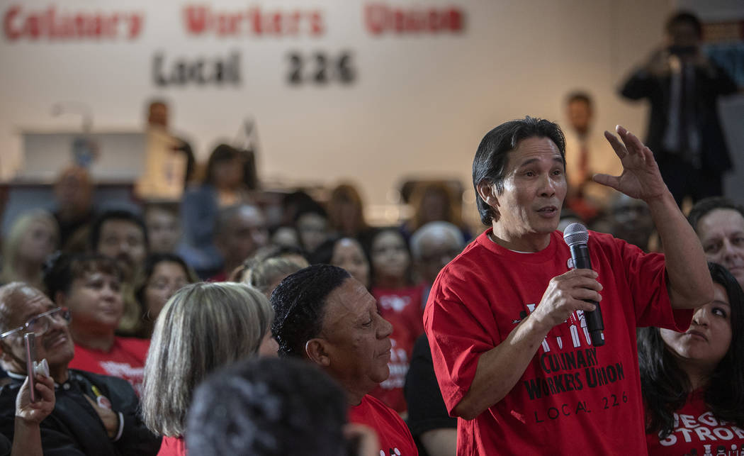 Members of the crowd at a UNITE HERE town hall ask presidential candidate Kamala Harris questio ...