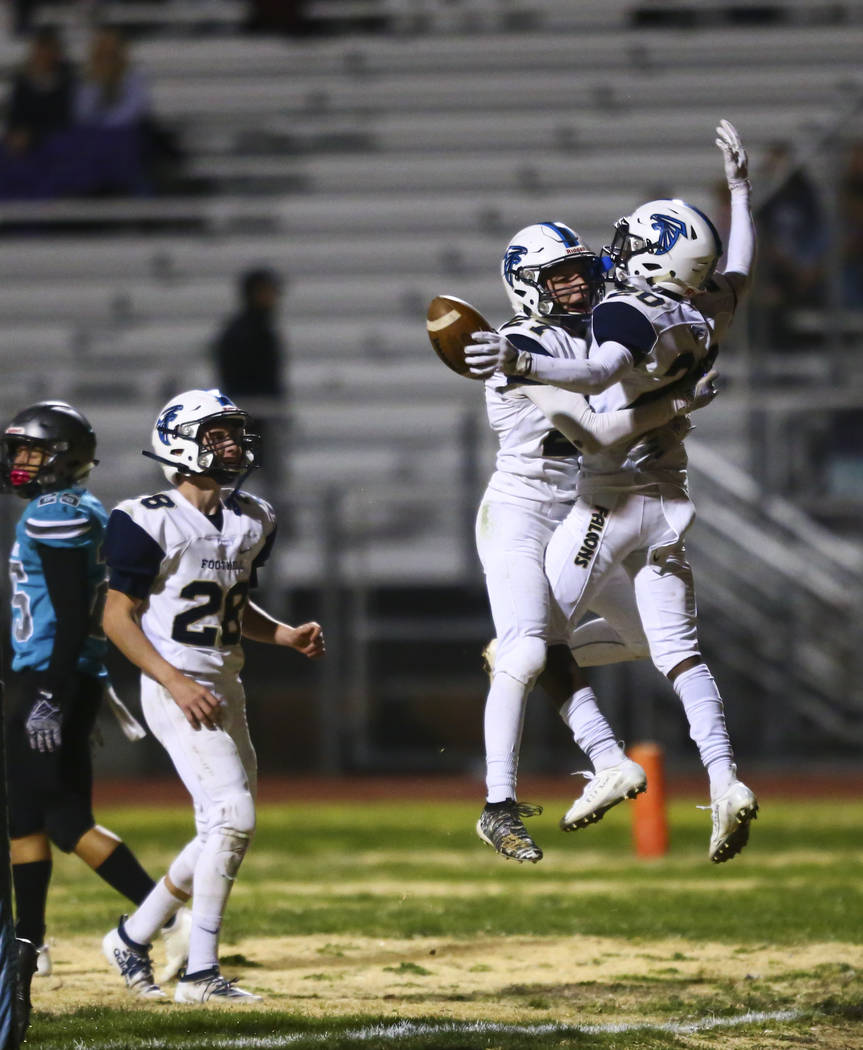 Foothill's Nathan Hargis (27) and Omari Canton (20) celebrate after breaking up a pass by Silve ...
