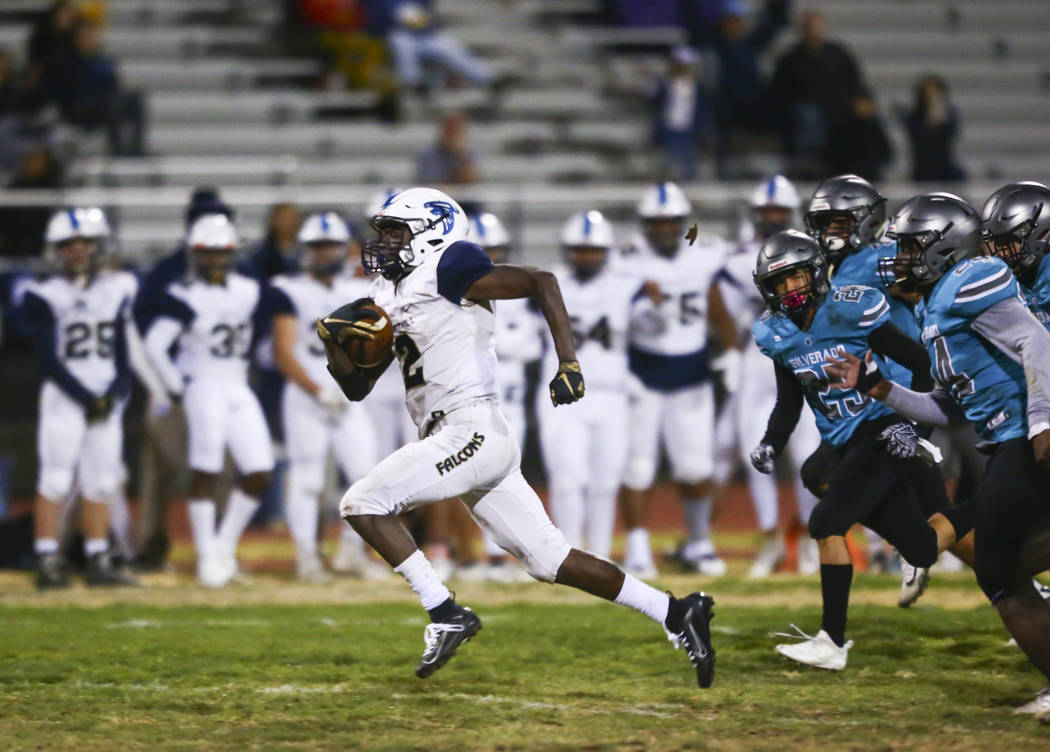 Foothill's Kendric Thomas (2) runs the ball past Silverado defenders during the second half of ...