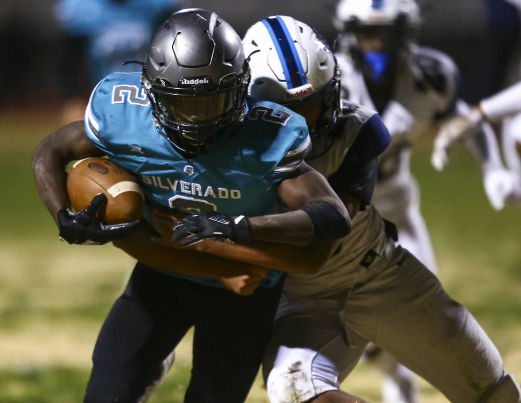Foothill's Vyron Rosquist Wallace (23) tries to stop Silverado's Aginae Cunningham (2) on his w ...