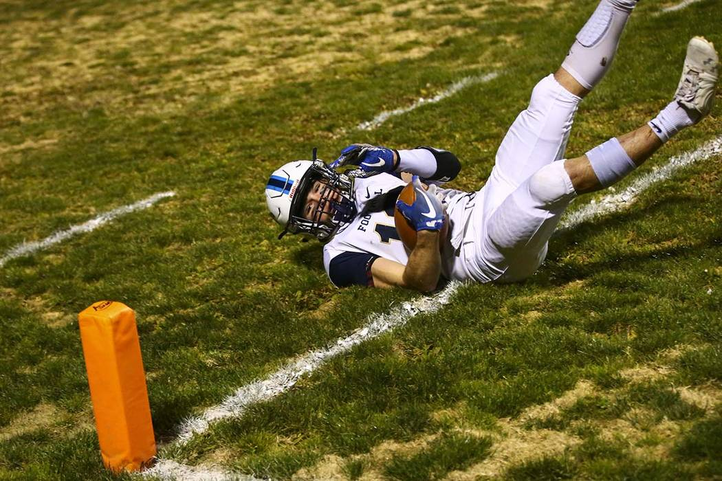 Foothill's Thomas Fisher-Welch (18) catches the ball for a touchdown during the first half of a ...