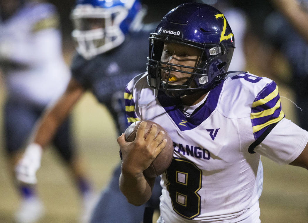 Durango's Ryan Cabase (8) streaks down the sideline for a big run in the first quarter during t ...