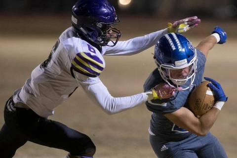 Green Valley's Noah Hawthorne (22) turns the corner past Durango's Michael Hayword (6) in the f ...