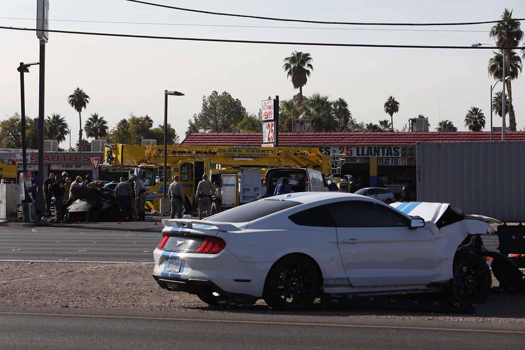 Las Vegas police investigate a two-vehicle crash that left two people dead early in the morning ...