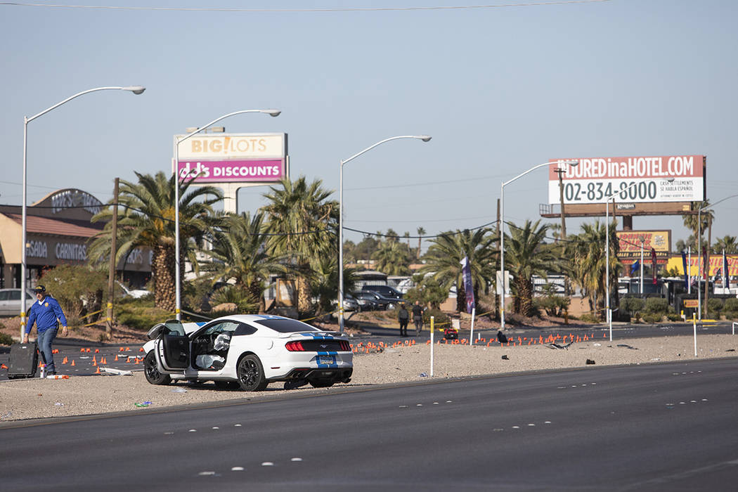 Police work around a vehicle involved in a suspected DUI crash that occurred early in the morni ...