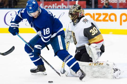 Toronto Maple Leafs left wing Andreas Johnsson (18) gets stopped by Vegas Golden Knights goalte ...