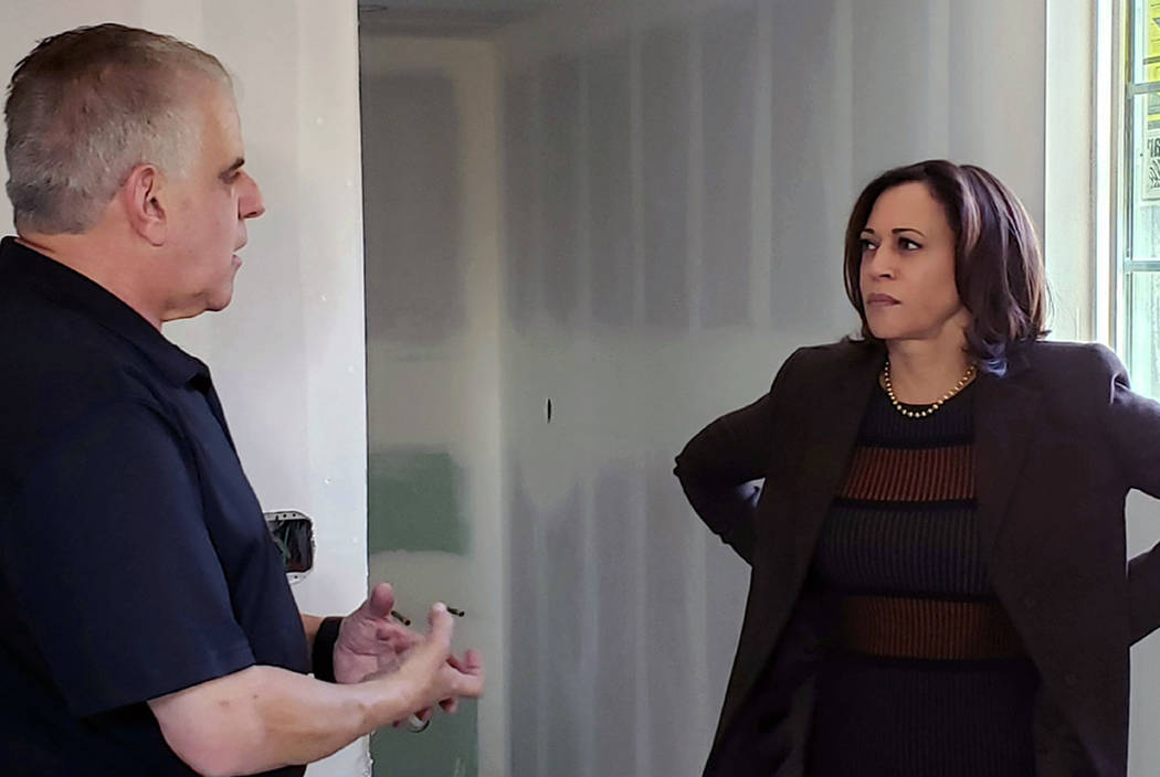 Democratic presidential candidate Sen. Kamala Harris, D-Calif., right, speaks with founder Arno ...