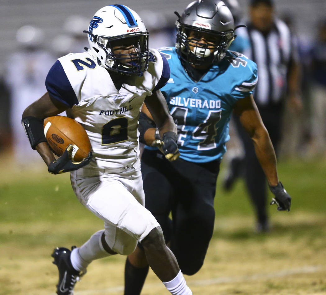 Foothill's Kendric Thomas (2) runs the ball past Silverado's Chris Federico (44) during the fir ...