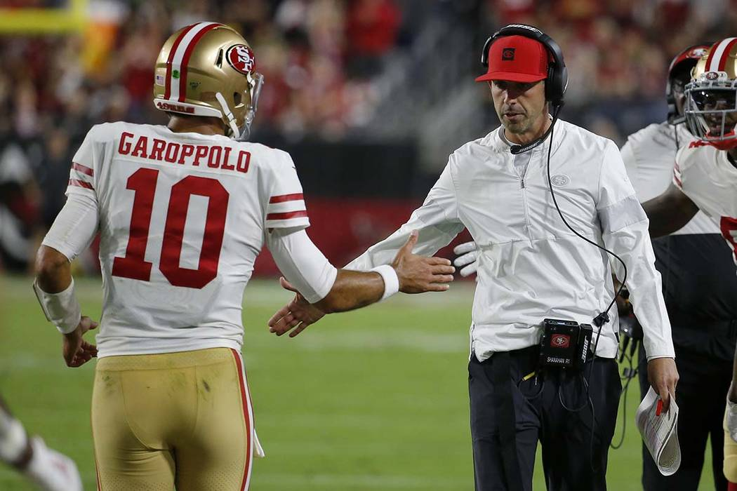 San Francisco 49ers quarterback Jimmy Garoppolo (10) greets San Francisco 49ers head coach Kyle ...