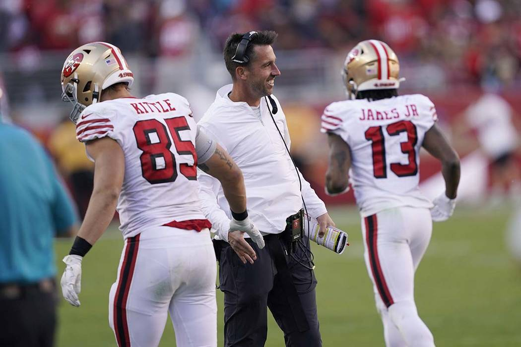 San Francisco 49ers head coach Kyle Shanahan greets tight end George Kittle (85) during the sec ...