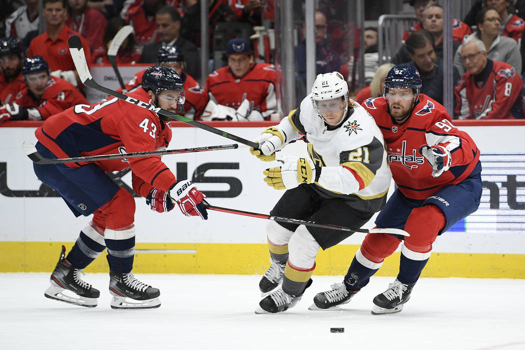 Vegas Golden Knights center Cody Eakin (21) battles for the puck against Washington Capitals ri ...