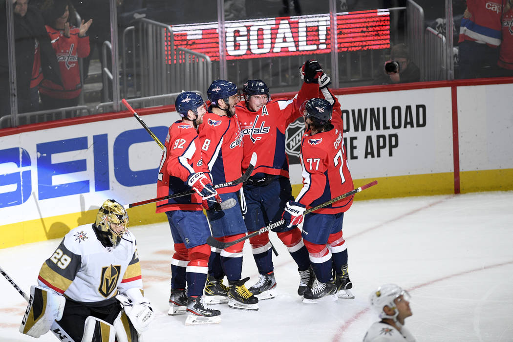 Washington Capitals center Nicklas Backstrom (19), of Sweden, celebrates his goal with right wi ...