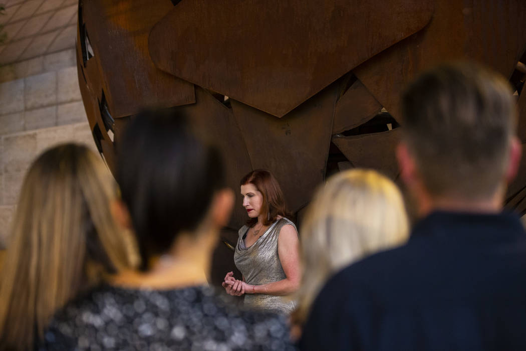 Artist Katy Boynton pauses for a moment of silence in memory of the victims of Oct. 1 during a ...