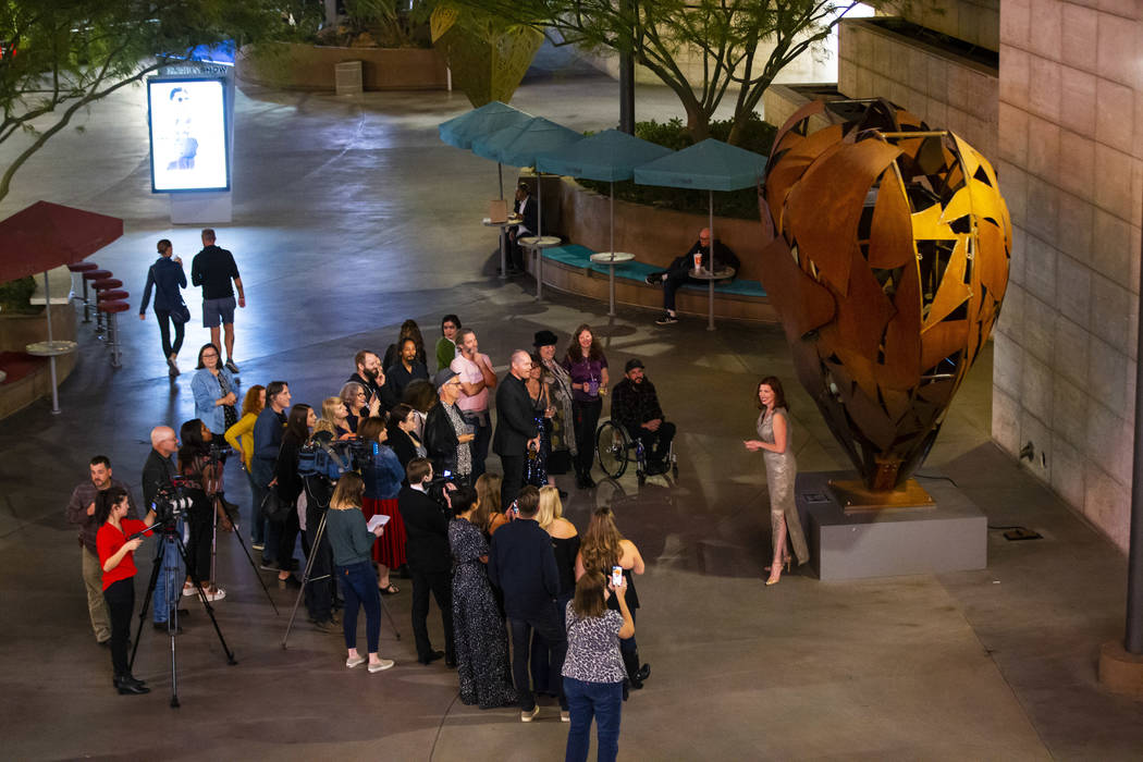 "Artist Katy Boynton, right, speaks during a dedication ceremony for the ""Heartfullness Veg ..."