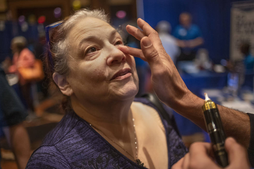 Jan Cobb of Las Vegas tries an anti-aging skincare product at the AgeWell Expo on Saturday, Nov ...